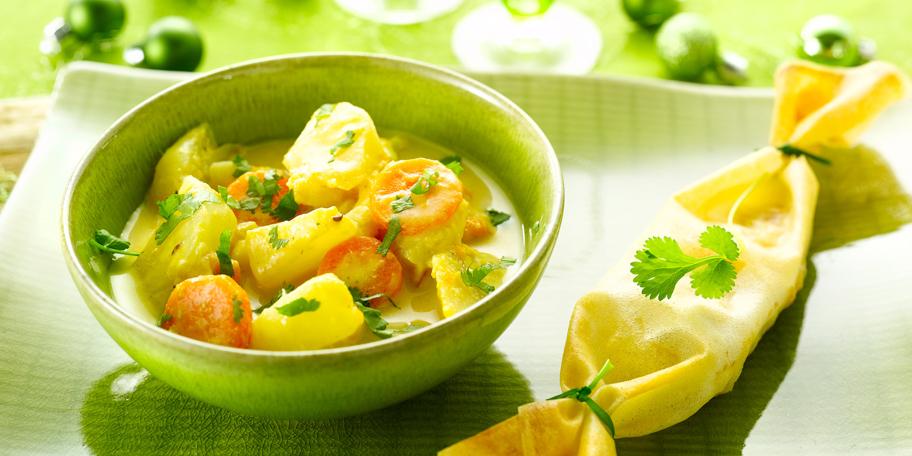 Pakketjes van parelhoen en curry van wortel-en knolgroenten